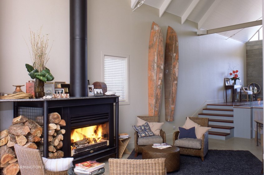 Wood fires, like this one from Warmington Fires, can be an effective and simple way to heat an off-grid home.
