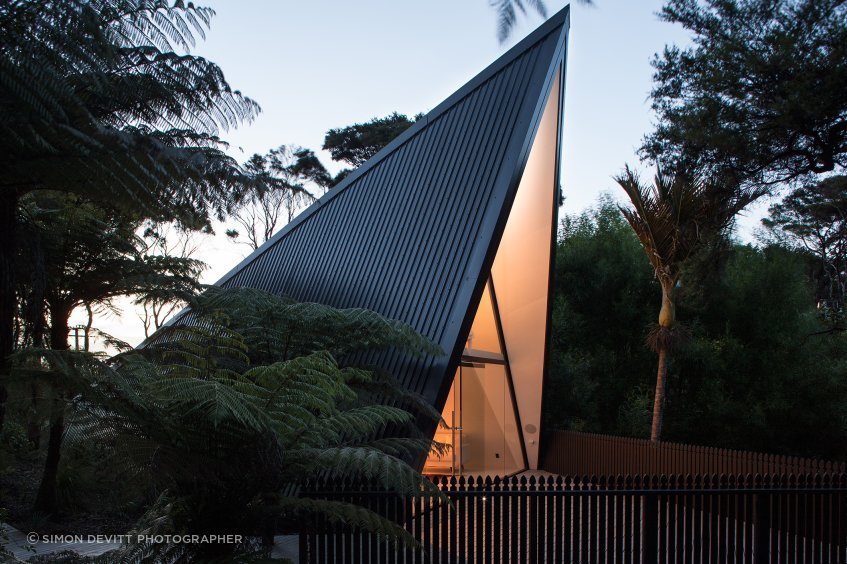 Chris Tate's Tent House on Waiheke Island utilises Colorsteel to clad both the roof and walls of this unusual A-frame structure.