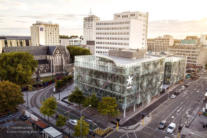 A contextual view of 2 Cathedral Square, showing the patterned glazed facade in relation to the patterned slate roof of ChristChurch Cathedral. Photograph: Dennis Radermacher/Lightforge.