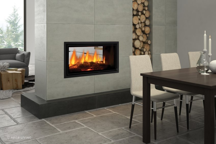 A see through fireplace is an elegant way to divide two spaces while retaining some feeling of openness.