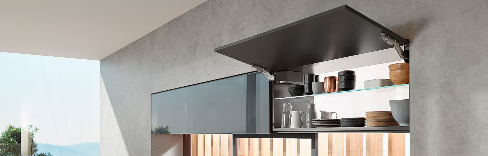 Give cabinet designs a lift with the AVENTOS HK top opening system