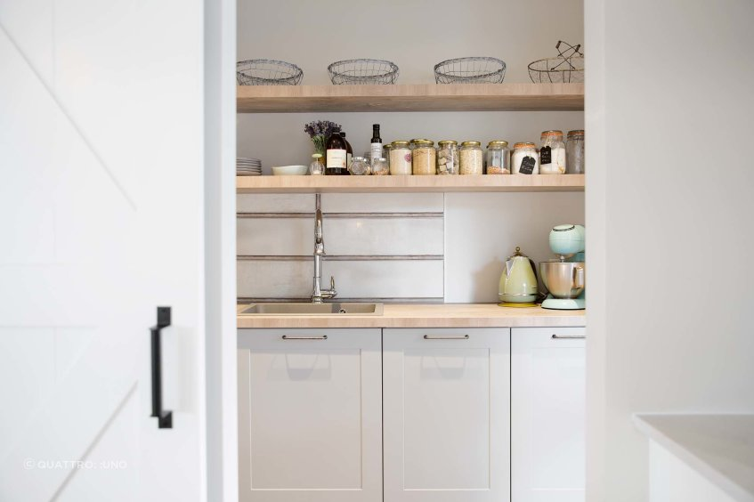 A stylish scullery with open shelving from Hacker Kitchens.