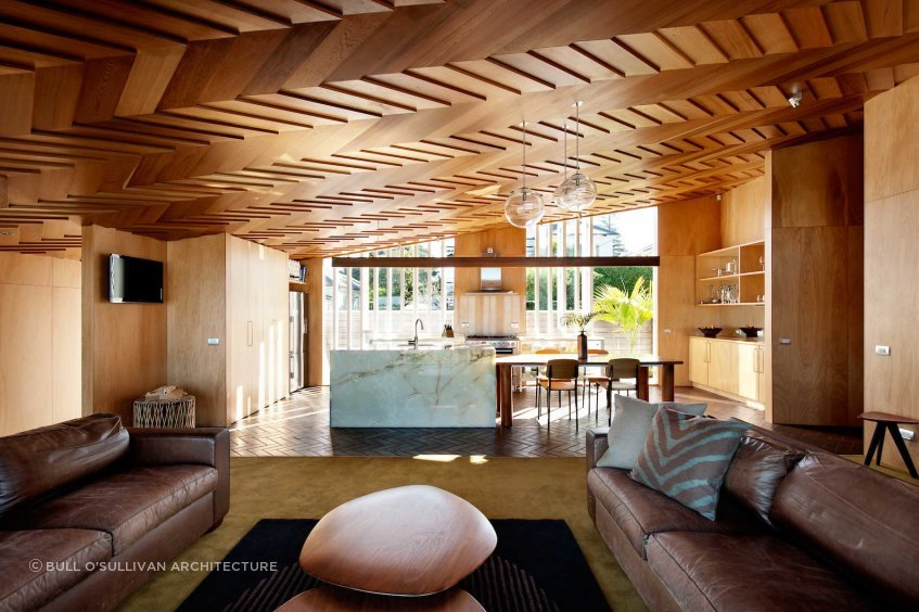 The warm and creative timber furniture and ceiling in the Wood Family Home, Auckland, was constructed by the client and the architect.