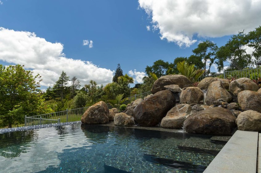 Natural rock pools like this one at Totara Park in South Auckland can be built into your back garden by Auckland Inground Pools.
