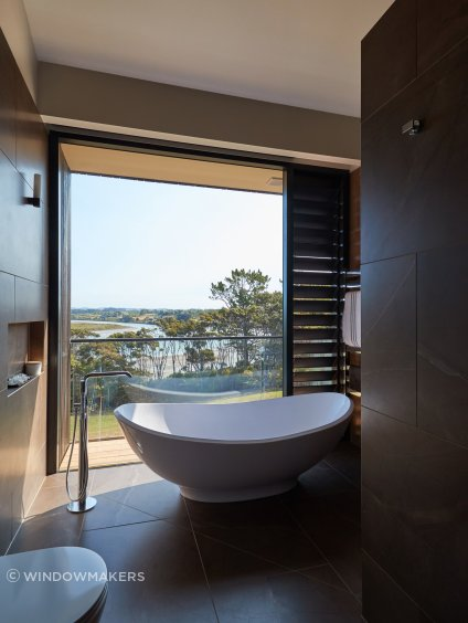A tranquil bathing experience with a view.