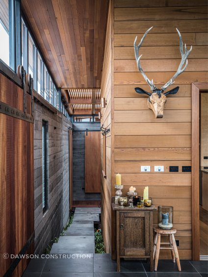 The barn door and stag'e head are crafted elements by Jamie Pickernell.