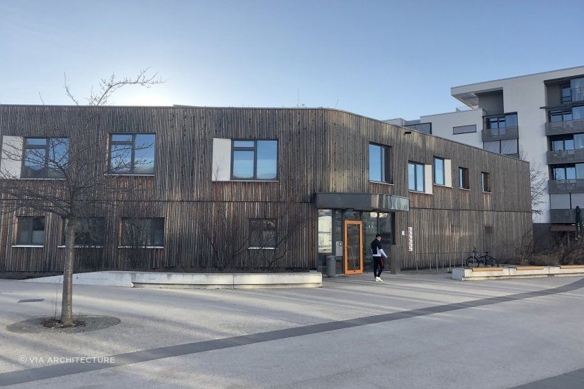 A timber-clad nursery school in the Barnstadt urban development in Heidelberg, Germany, which includes apartments, cafes, schools, offices all constructed to 'passive house' standard.
