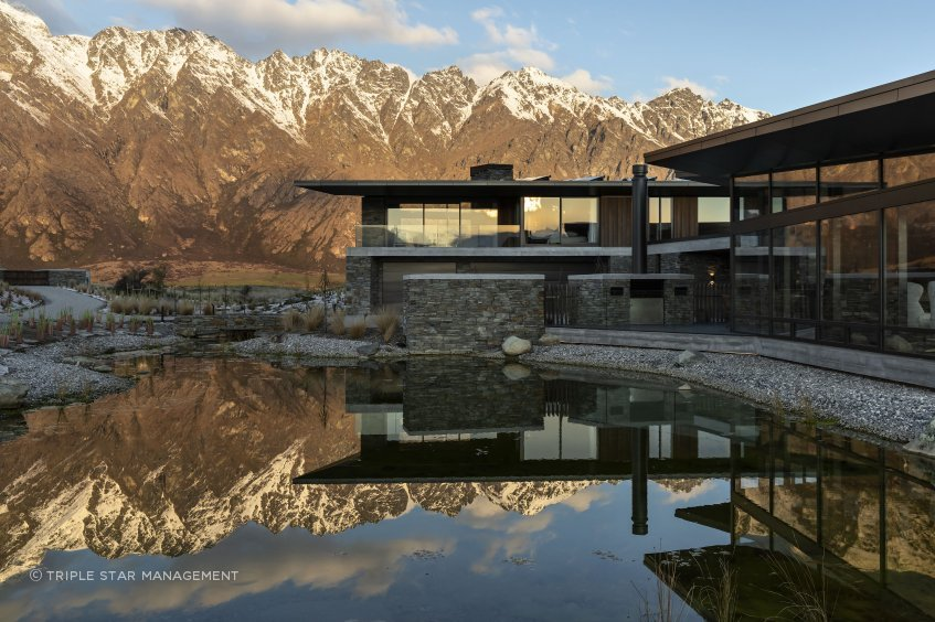 A view from the reflection pool of Hidden Island Retreat and the surrounding mountain ranges.