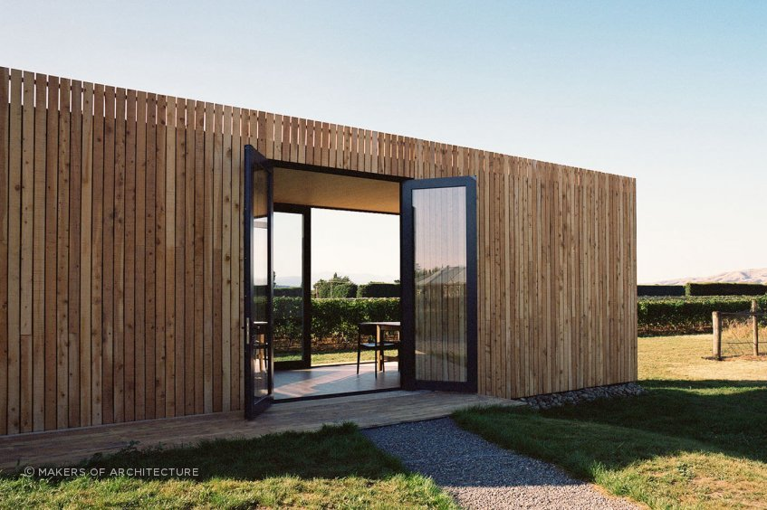 Located on a Martinborough vineyard,On Giant's Shoulders' tasting room was prefabricated using CLT construction as a complete building in Wellington, then transported over the Rimutaka Ranges via truck and assembled on site.