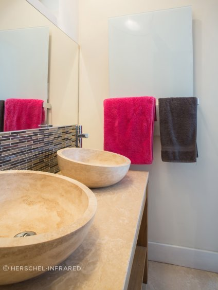 Infrared mirror heater panels keep bathroom walls and fittings warm, dry and free of mould.